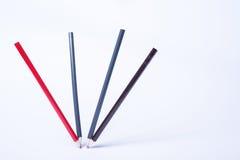 作为静物画的四支跳舞的铅笔在白色背景 免版税图库摄影