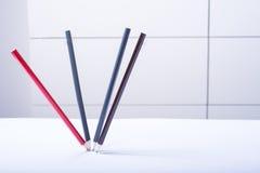 作为静物画的四支跳舞的铅笔在白色背景 免版税库存照片