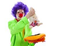 作为滑稽的小丑打扮的孩子 免版税库存照片