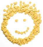作为兴高采烈的面孔被安排的玉米片 免版税库存图片