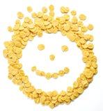 作为兴高采烈的面孔被安排的玉米片 免版税库存照片