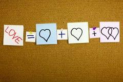 作为mathematica或者浪漫关系概念被提出的一个黄色稠粘的笔记柱子文字、说明、题字等式爱 免版税图库摄影