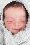 作微笑的婴孩 免版税库存图片