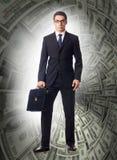 作战与美元漏斗的商人 免版税库存照片