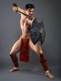 作战姿态的古老战士 免版税库存图片