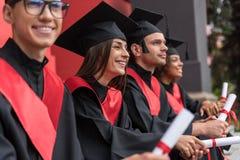 作梦关于成功的事业的正面毕业生 库存照片