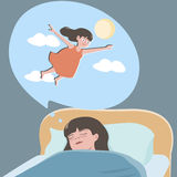 作梦关于飞行的小女孩 免版税库存图片