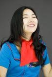 作白日梦亚裔空气的空中小姐 免版税图库摄影