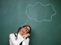 作白日梦年轻女性的书呆子 免版税库存图片