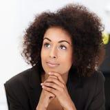 作白日梦年轻非裔美国人的妇女 库存图片