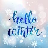 你好冬天文本 刷子字法在蓝色冬天 库存图片