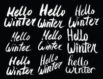 你好冬天汇集文本 向量 字法 用手画 说明刷子 信函 库存照片