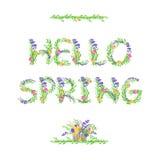 你好春天 与花和叶子的字法 免版税库存图片