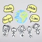 你好用不同的国际全球性外语Bonjour Ciao Hola 免版税图库摄影