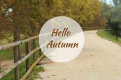 你好秋天与离开的石渣路的贺卡在背景中 库存图片