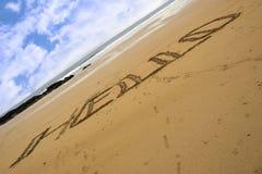你好题写在一个沙滩 库存照片
