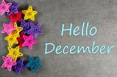 你好12月,冬天和圣诞节装饰受欢迎的冬天贺卡框架海报 库存照片