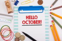 你好10月 成功的企业背景 有文具和手机的办公桌 免版税库存照片