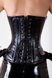 佩带专业腰部培训corse的妇女 免版税库存图片