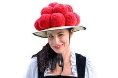 佩带传统Bollenhut的可爱的妇女 免版税库存照片