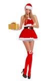 佩带圣诞老人的美丽的性感的女孩穿衣与圣诞节礼物 查出在白色 免版税图库摄影