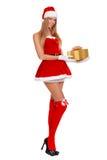 佩带圣诞老人的美丽的性感的女孩穿衣与圣诞节礼物 查出在白色 免版税库存照片