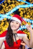佩带圣诞老人的美丽的性感的女孩画象穿衣 库存照片