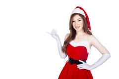 佩带圣诞老人的美丽的性感的妇女在whi穿衣 免版税图库摄影