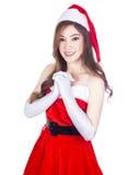 佩带圣诞老人的美丽的性感的妇女在whi穿衣 库存图片