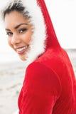 佩带圣诞节的可爱的妇女称呼了套头衫 免版税库存图片