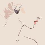 佩带妇女的美丽的耳环 库存照片
