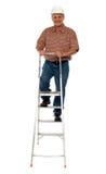 佩带安全帽上升的梯子的工作者 库存图片