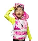 佩带救生背心和废气管集合的亚裔女孩 免版税库存图片