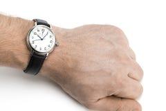 佩带有黑皮带的人一块手表在白色后面 库存图片