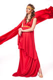 佩带红色礼服古董样式的美丽的年轻女性被隔绝 免版税库存图片