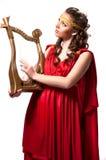佩带红色礼服古董样式的美丽的年轻女性被隔绝 库存照片
