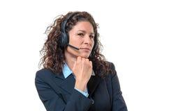 佩带耳机的投机的女实业家 免版税图库摄影