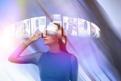 佩带虚拟现实玻璃的妇女的综合图象 免版税图库摄影