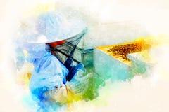 佩带防护成套装备观看的蜂的Yung蜂农在蜂箱和软软地被弄脏的水彩背景 免版税库存图片