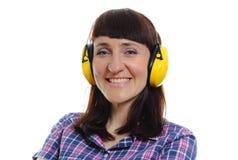 佩带防护耳机的建造者妇女 免版税库存照片