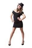 佩带黑礼服和经典之作的快乐的俏丽的女孩 免版税图库摄影