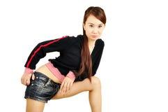 佩带年轻人的亚洲女孩短裤 库存图片