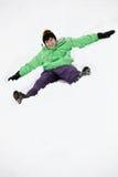 使倾斜雪的天使男孩少年 免版税库存照片