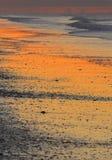 使日出靠岸 库存照片