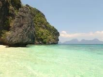 使海岛沙子白色靠岸 库存照片