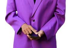 使用一个巧妙的手机的专业商人在白色背景 库存照片