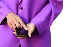 使用一个巧妙的手机的专业商人在白色背景 免版税库存图片