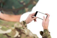 使用一个手机的战士 库存图片