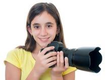 使用一台专业照相机的女孩隔绝在白色 免版税库存照片