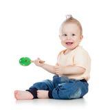 使用与在空白backgroun的音乐玩具的男婴 图库摄影